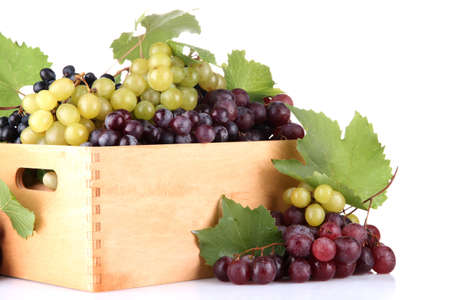assortment of ripe sweet grapes in wooden crate, isolated on white  Stock Photo