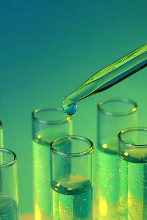 reagents: test-tubes with liquid on blue background Stock Photo