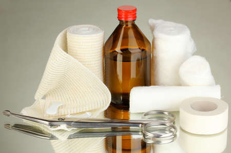 First aid kit for bandaging on grey background Stock Photo - 18695351