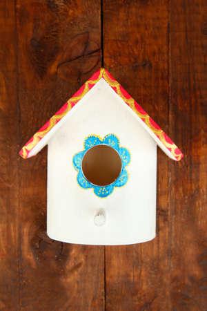 Decorative nesting box on wooden background photo