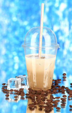 Cold coffee with ice in glass on blue background Stock Photo - 18716491