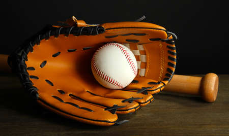 Baseball glove, bat and ball on dark background Stock Photo - 18716419