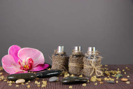 Spa oil on bamboo mat on bright background photo