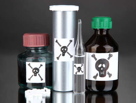 deadly poison: Deadly poison in bottles on black background Stock Photo