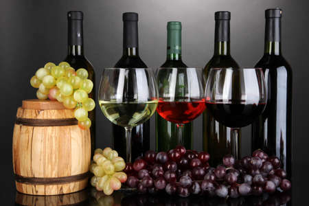 Assortment of wine in glasses and bottles on grey background Stock Photo - 18717703