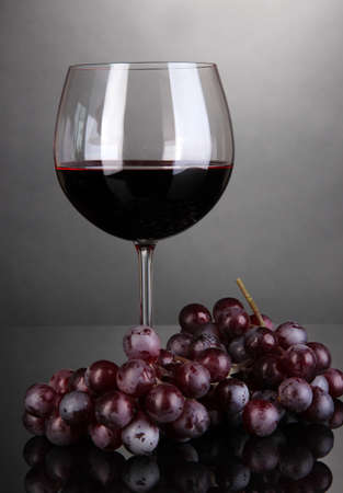 tannin: Red wine glass on grey background