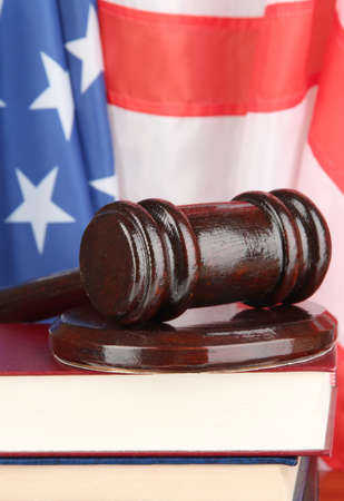 Judge gavel and books on american flag background Stock Photo