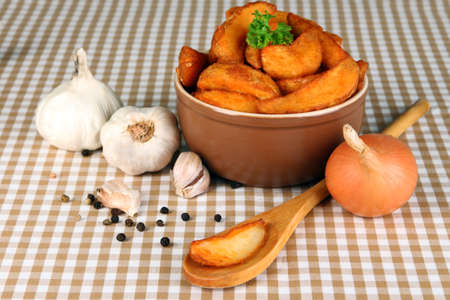nutritiously: Appetizing village potatoes in bowl on beige tablecloth close-up Stock Photo