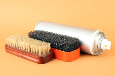 Set of stuff for cleaning and polish shoes, on color background Stock Photo - 18741847
