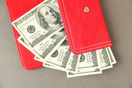 Purse with hundred dollar banknotes, on color background Stock Photo - 18742159