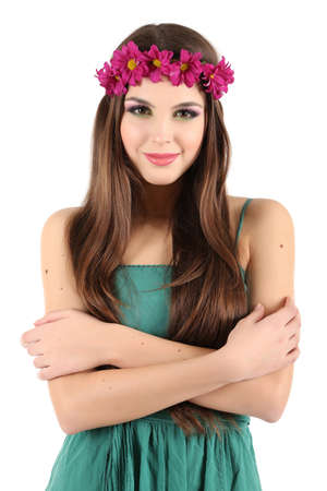 Young beautiful girl in green dress with bright wreath on her head, isolated on white photo