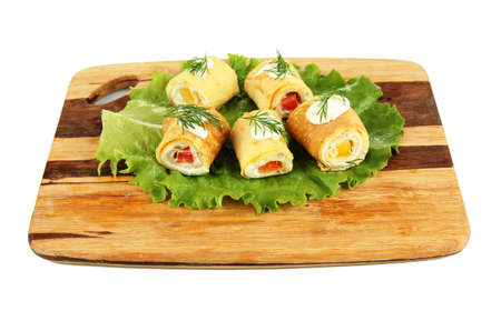Egg rolls with cheese cream and paprika, on wooden board, isolated on white Stock Photo - 18741751