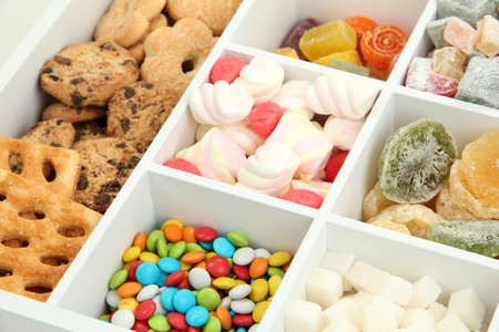 Multicolor candies and cookies in white wooden box close up Stock Photo - 18742010