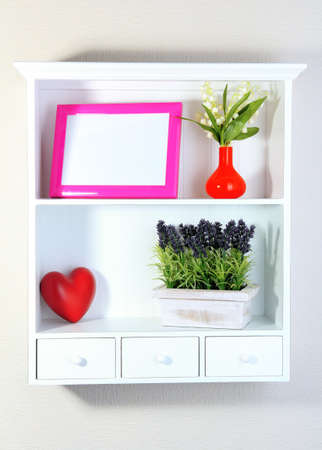 home related: Beautiful white shelves with different home related objects Stock Photo