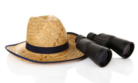 Black modern binoculars with straw hat isolated on white Stock Photo - 18741477