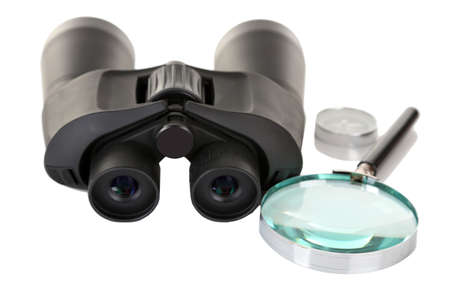 Black modern binoculars with magnifying glass and compass isolated on white Stock Photo - 18741444