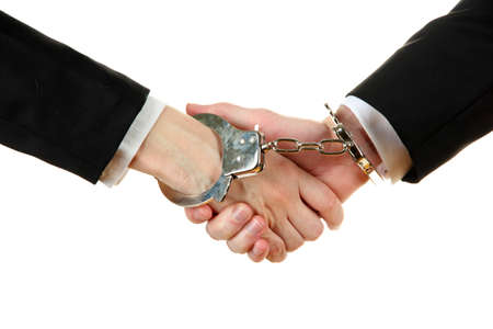 Man and woman hands and breaking handcuffs isolated on white background photo