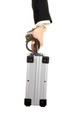 Hand with handcuff and suitcase, isolated on white photo