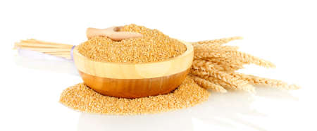 spikelets: arnautka in wooden bowl with spikelets isolated on white Stock Photo