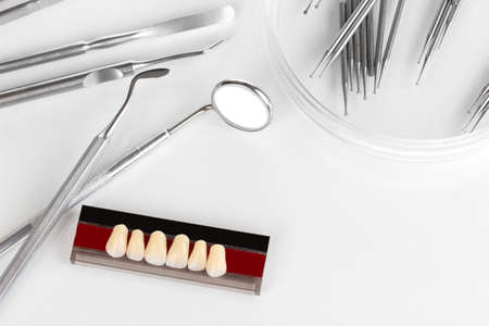 prophylactic: denture with dental tools isolated on white Stock Photo