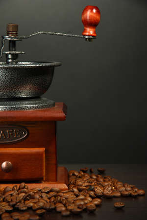 Coffee grinder with coffee beans on grey background Stock Photo - 18776449
