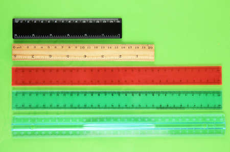 width: Rulers on green background Stock Photo