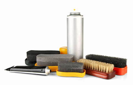 Set of stuff for cleaning and polish shoes, isolated on  white photo