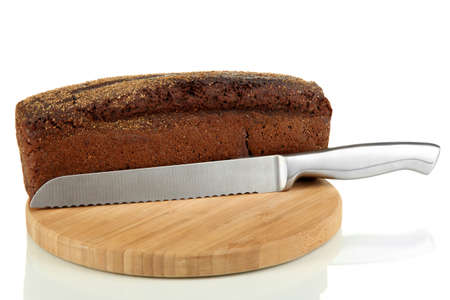 Black bread with sesame seeds and knife on wooden board isolated on white Stock Photo - 18776440