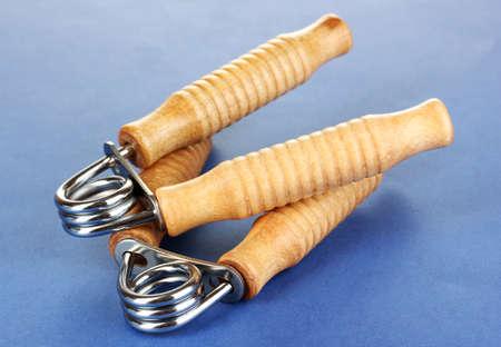 espander: Modern hand trainer on blue background Stock Photo