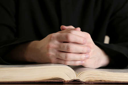 bible reading: Priest reading from the holy bible, close up