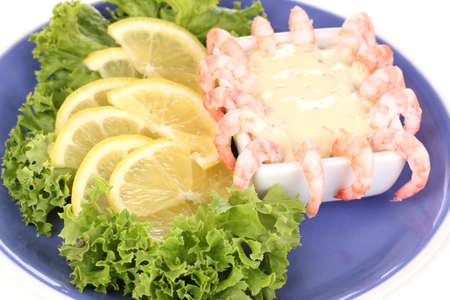 Delicious marinated shrimp with sauce served on plate close-up photo