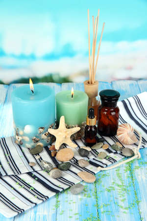 Sea spa composition on wooden table on blue natural background Stock Photo - 18801331
