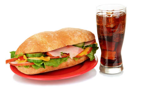 Tasty ham sandwich and glass of cola with ice isolated on white Stock Photo - 18800675