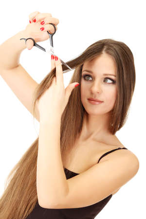 Beautiful woman with long hair and hairdresser's scissors, isolated on white Stock Photo - 19035119