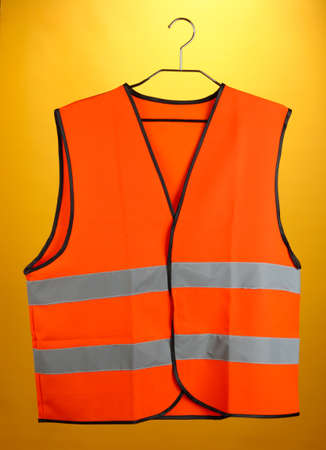 Orange vest, on color background Stock Photo - 18801111