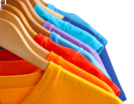 Lots of T-shirts on hangers isolated on white Stock Photo - 18801013