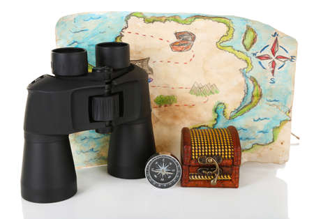 Black modern binoculars with map and compass isolated on white photo