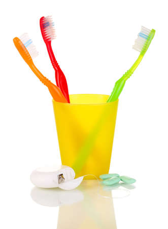 Toothbrushes, chewing gum and dental floss isolated on white photo