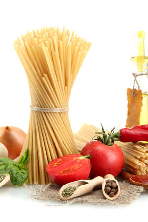 Pasta spaghetti, vegetables and spices and oil, isolated on white Stock Photo - 18866938
