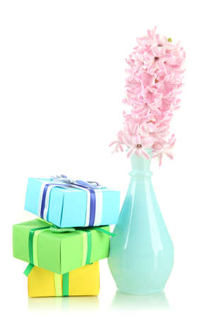 Beautiful hyacinth in vase and beautiful gifts, isolated on white photo