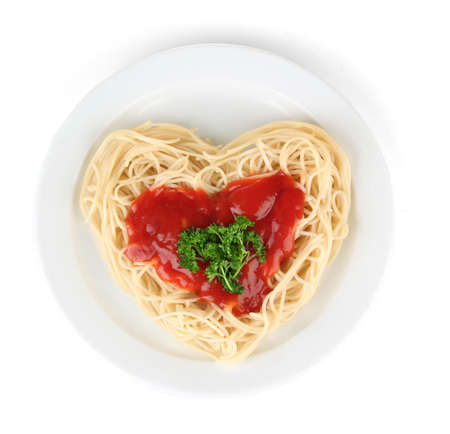 carefully: Cooked spaghetti carefully arranged in  heart shape and topped with tomato sauce, isolated on white