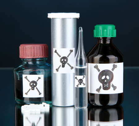 deadly: Deadly poison in bottles on black background Stock Photo