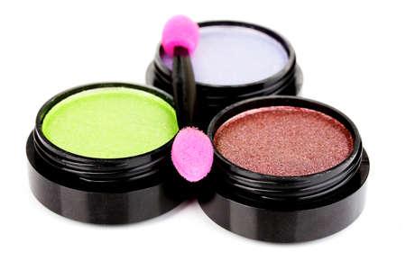 applicator: Bright eye shadows and sponge brushes for foundation isolated on white Stock Photo