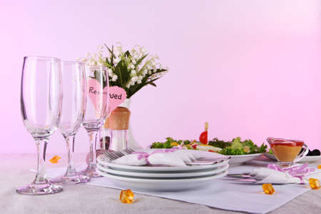 Table setting on yellow background photo