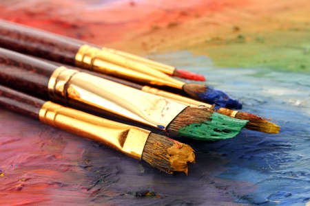 acrylic paint and brushes on wooden palette Stock Photo - 18921244