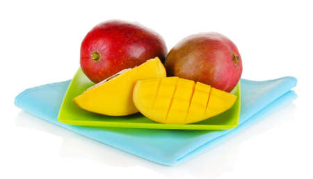 Ripe appetizing mango on green plate isolated on white Stock Photo - 18920991