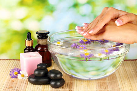 spa treatments for female hands,  on bright green background photo