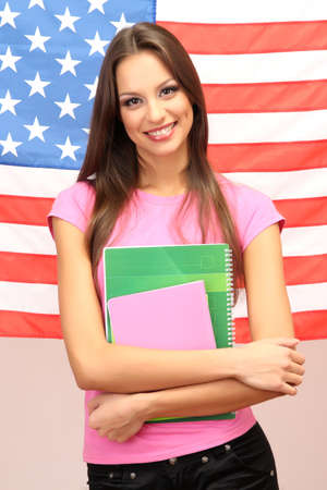overseas visa: Young woman with American flag Stock Photo