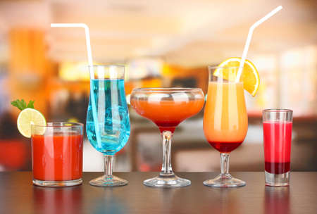 Several glasses of different drinks on bright background Stock Photo - 18941438