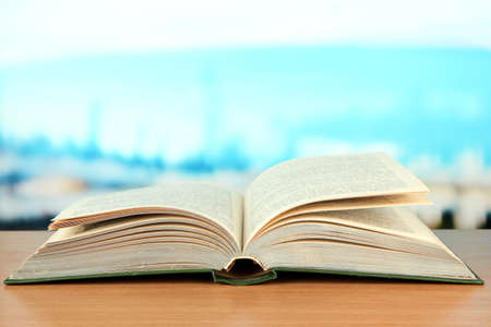 law school: Opened book on bright background